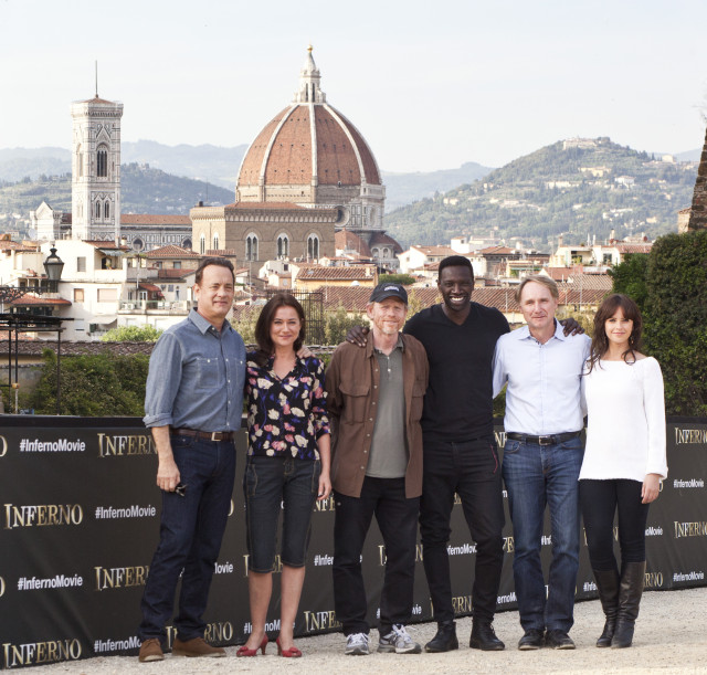 """Sony Pictures Entertainment commences principal photography in Florence, Italy on """"INFERNO,"""" the new film in the billion-dollar Robert Langdon franchise, based on Dan Brown's bestselling series of books.   Pictured: (Left to Right) Tom Hanks (""""Robert Langdon"""");  Sidse Babett Knudsen (""""Dr. Elizabeth Sinskey""""); Ron Howard, director/producer; Omar Sy (""""Christoph Bouchard""""); Dan Brown """"Inferno"""" Author; Felicity Jones (""""Dr. Sienna Brooks"""");   - Event Date: 11 May 2015"""